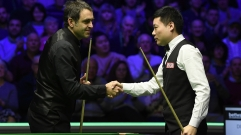 Ronnie O'Sullivan (L) shakes hands with Ding Junhui after the fourth round of the UK Championship at The Barbican, York, England, December 5, 2019.